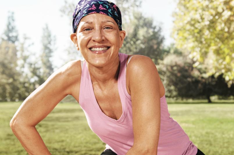 Cancer survivor smiling at the park