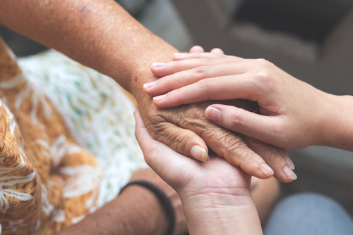 caregiver-holding-hands-with-patient