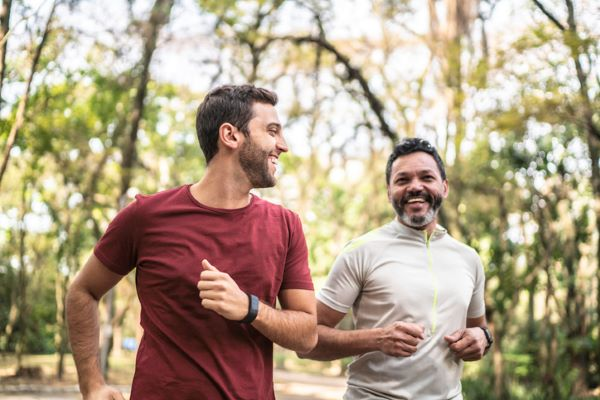 Two men running for exercise in a park