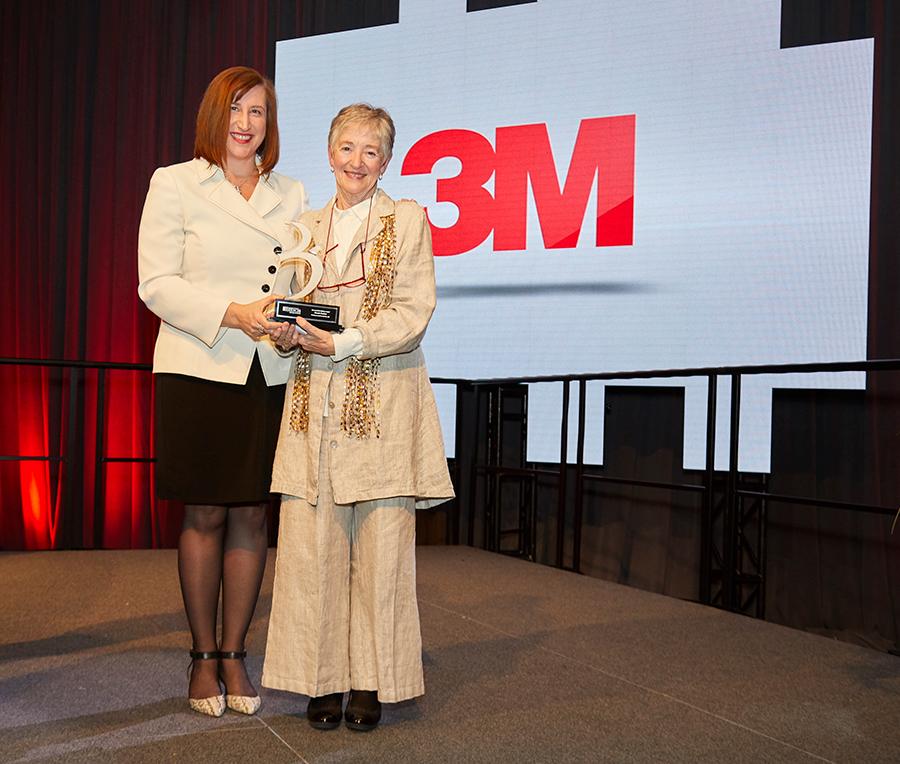 Maude receiving award