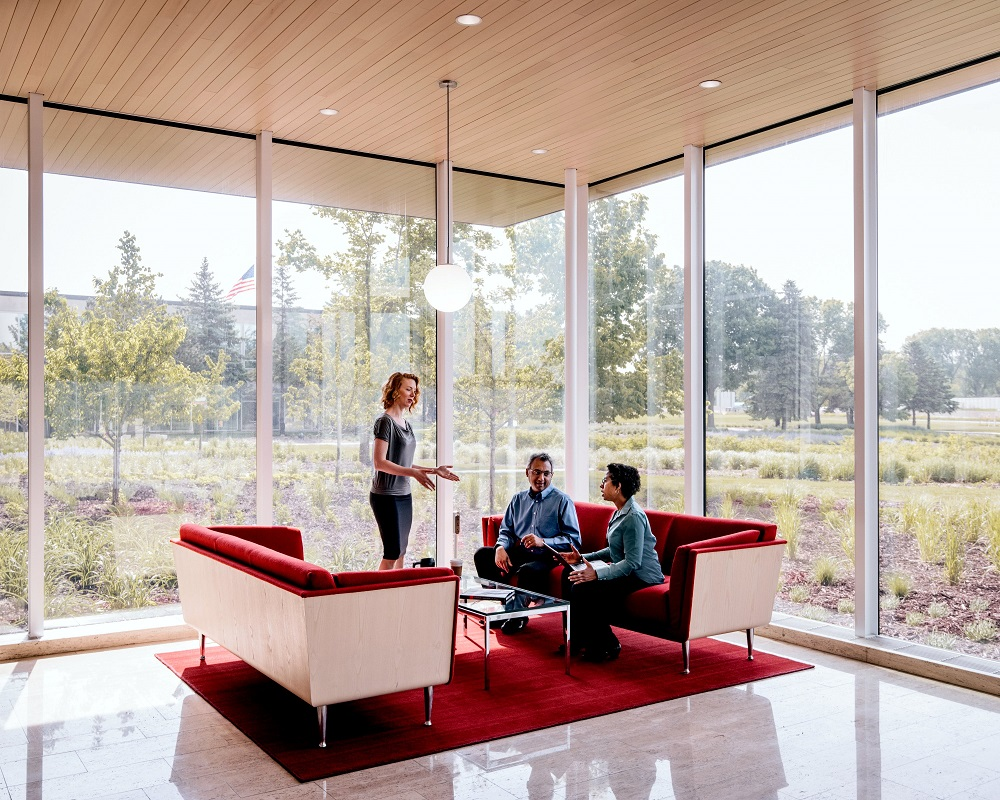 office workers meeting in open concept environment