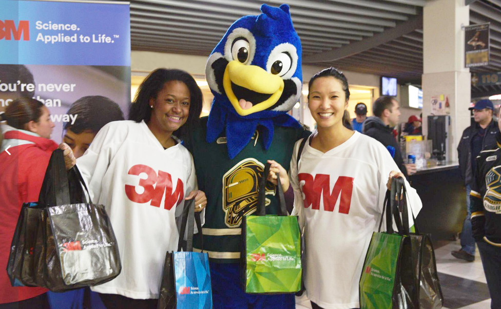3M employees at hockey event