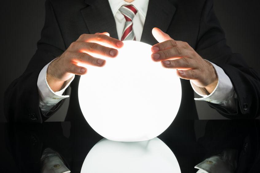 Man looking at crystal ball