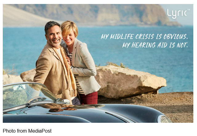 "Lyric add showing male and female leaning on a car near water that reads ""My midlife crisis is obvious. My hearing aid is not."""