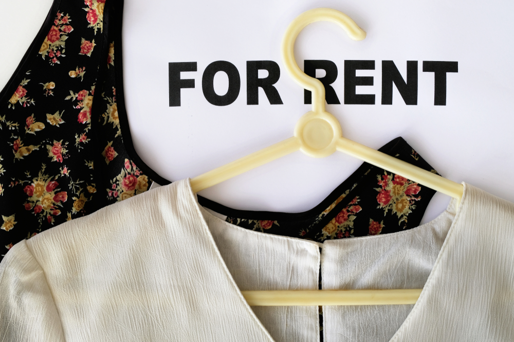 Shutterstock_1555080212 Women's blouses on the words FOR RENT. Design concept for clothing rental where customers can expand their wardrobe by renting a wide selection of clothes and branded designer apparels on a budget.