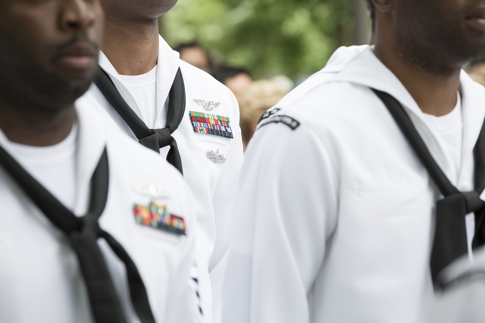 Shutterstock_665844325 Close up of military medals, ribbons, and neck scarves worn by U.S. Navy personnel at the re-enlistment and promotion ceremony on National September 11 Memorial site. Fleet Week, NEW YORK MAY 26 2017