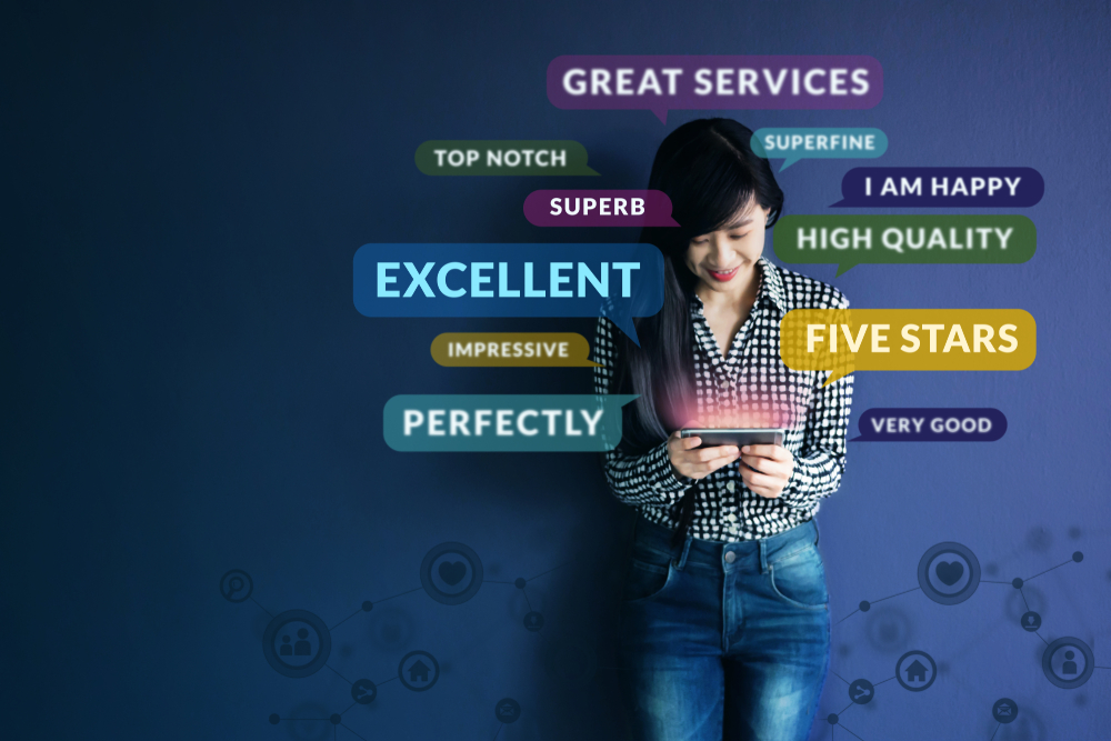Shutterstock_1074687401 Customer Experience Concept. Soft focus of Happy Client standing at the Wall, Smiling while using Smartphone. Surrounded by Positive Review in Speech Bubble and Social Network icons