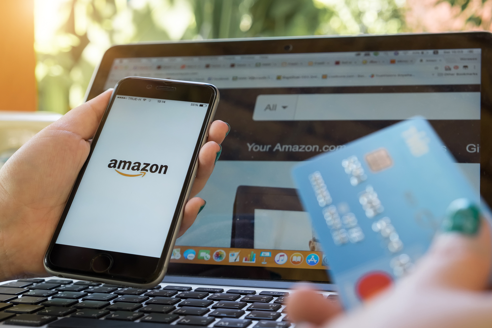 Shutterstock_765543979  CHIANG MAI,THAILAND - NOV 30, 2017 : iPhone 6s showing Amazon logo and credit card shopping online. Amazon.com, Inc. American international electronic commerce company.