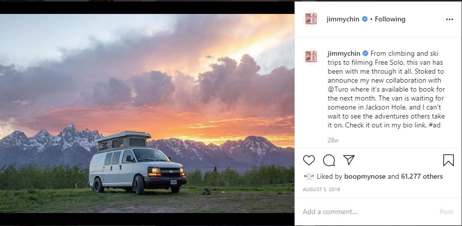 Jimmy chin white truck in front of mountains and a sunset