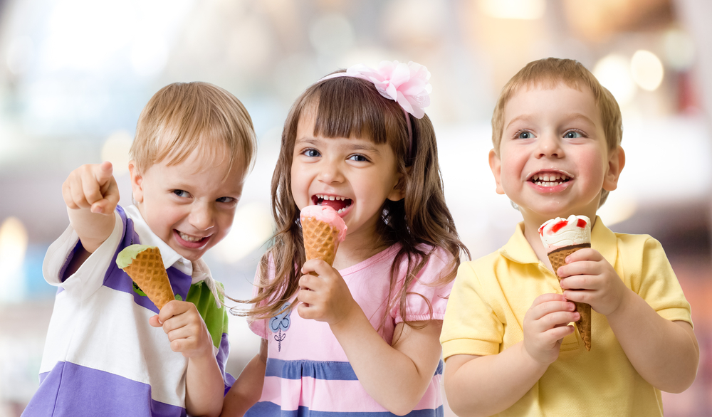 Shutterstock_188370806  funny children group kidding with ice cream on party