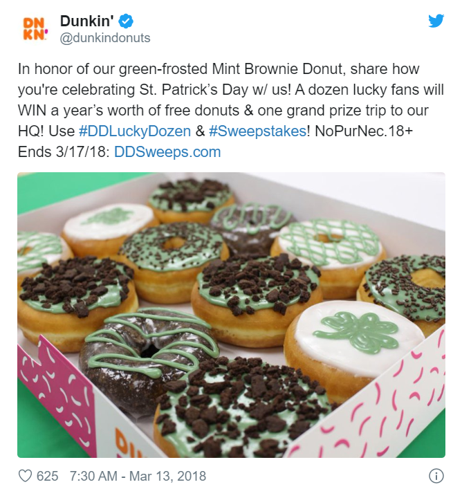 Dunkin donuts st. patrick's day post with picture of a box of donuts from Twitter
