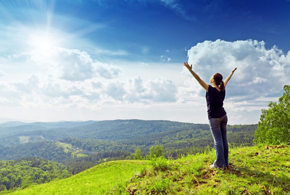 Shutterstock_95278852  Young woman enjoying the fresh air.