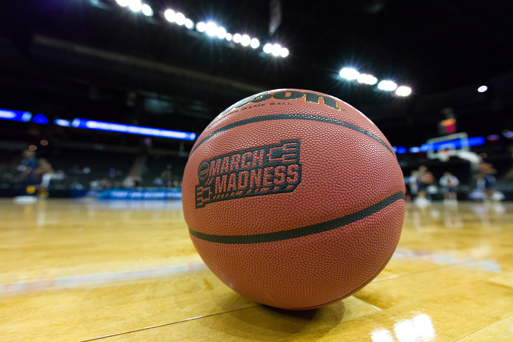 Shutterstock_396222472  March 17, 2016 - Spokane, WA: A game ball sits on court the day prior to the start of the 2016 NCAA Men's Basketball Tournament games at the Spokane Veterans Memorial Arena.