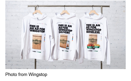 "White sweatshirts hanging on a rack, ""This is an Ad for Wingstop"" Photo from Wingstop"