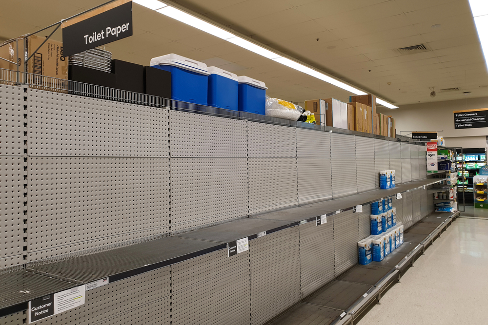 Shutterstock_1666793398  Gold Coast, Australia - March 8, 2020: Coles supermarket empty toilet paper shelves amid coronavirus fears, shoppers panic buying and stockpiling toilet paper as Australia prepares for a pandemic.