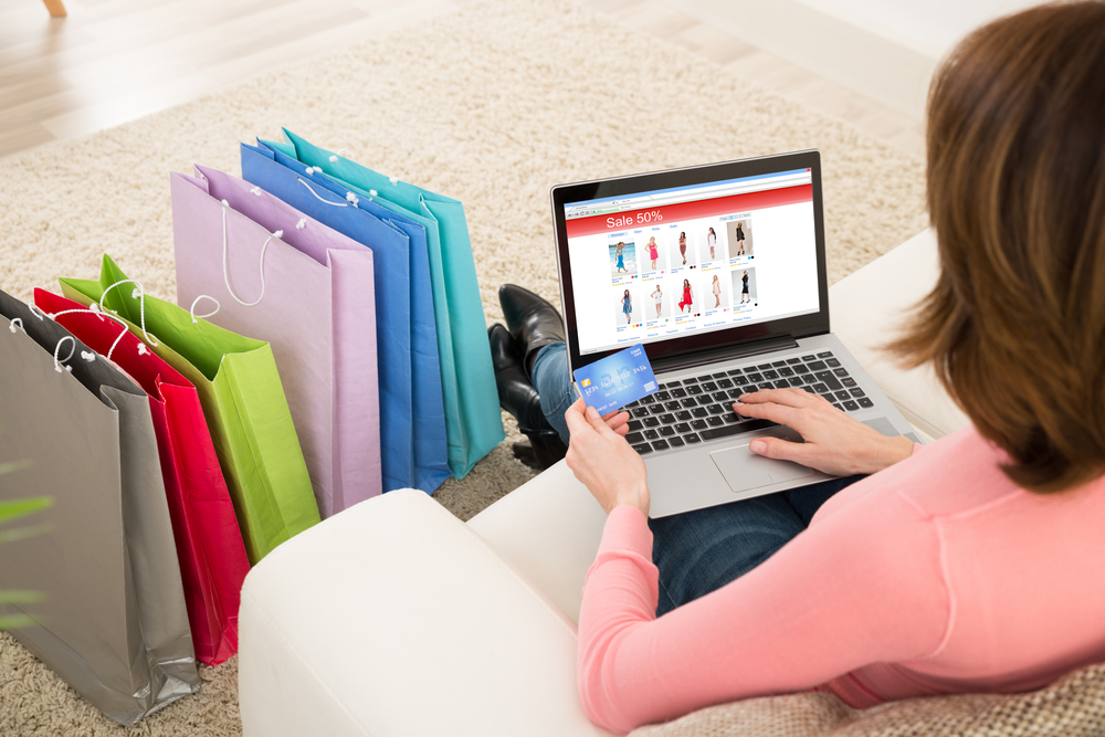 Shutterstock_389433475  Young Woman On Sofa Shopping Online With Debit Card