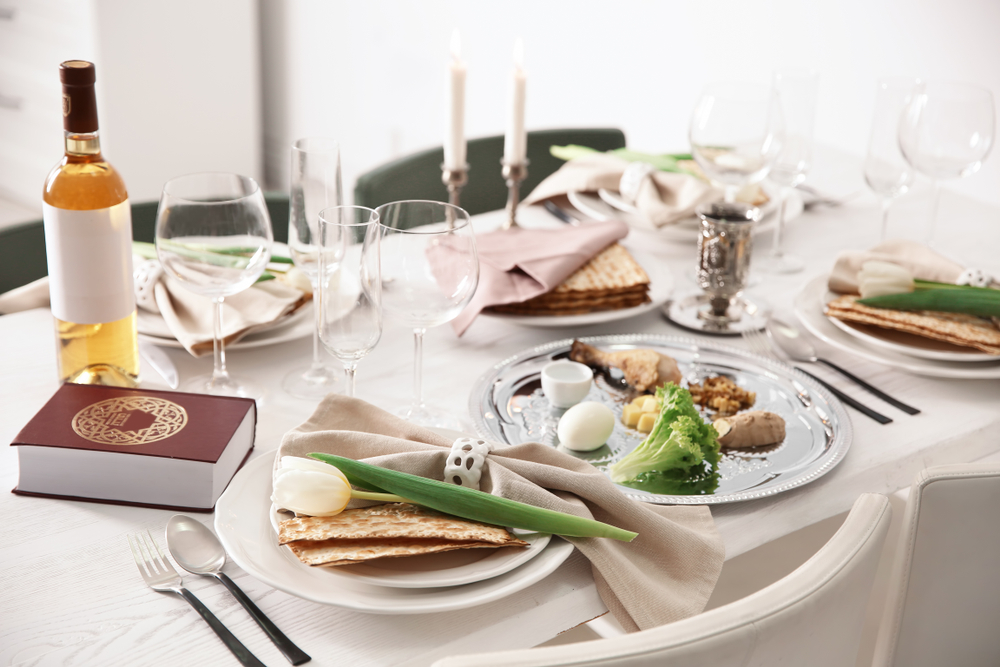 Shutterstock-1328002358 Festive Passover table setting with Torah. Pesach celebration