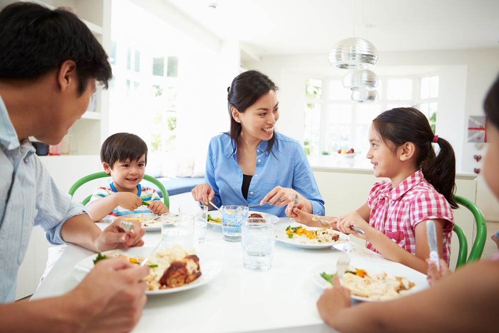 Shutterstock_177030098 Asian Family Sitting At Table Eating Meal Together