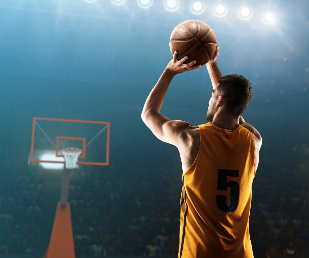 Shutterstock_1293705412  Professional basketball player shoots a three point shot