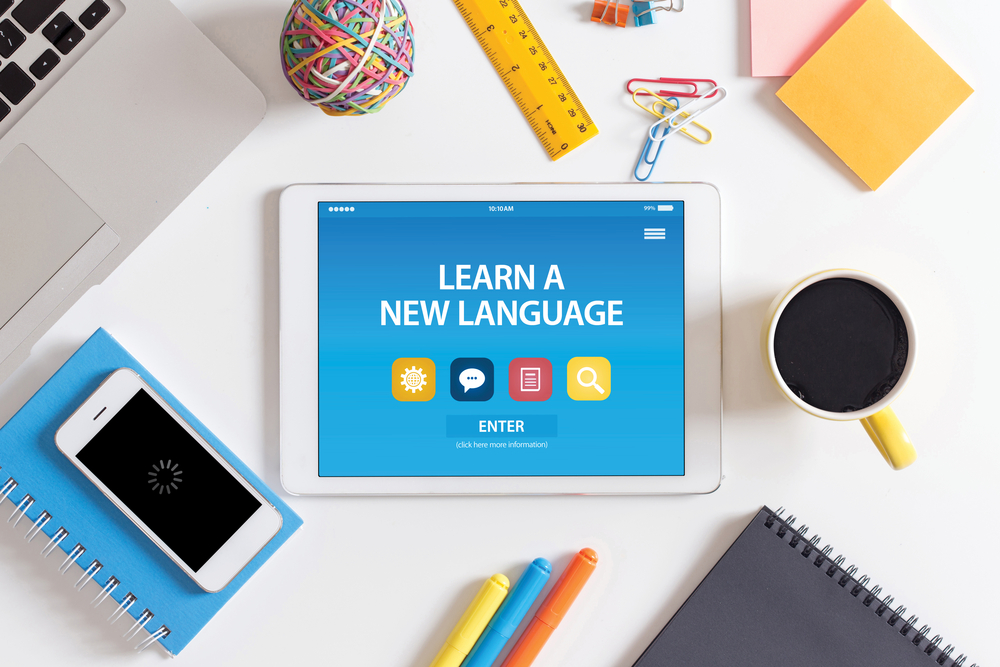 Shutterstock_526852489 LEARN A NEW LANGUAGE CONCEPT ON TABLET PC SCREEN