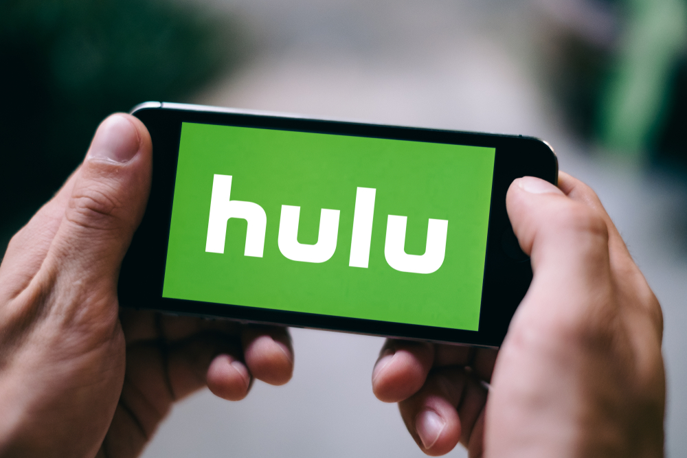 Shutterstock_1034739478 COLOGNE, GERMANY - FEBRUARY 27, 2018: Closeup of Hulu logo displayed on Apple iPhone