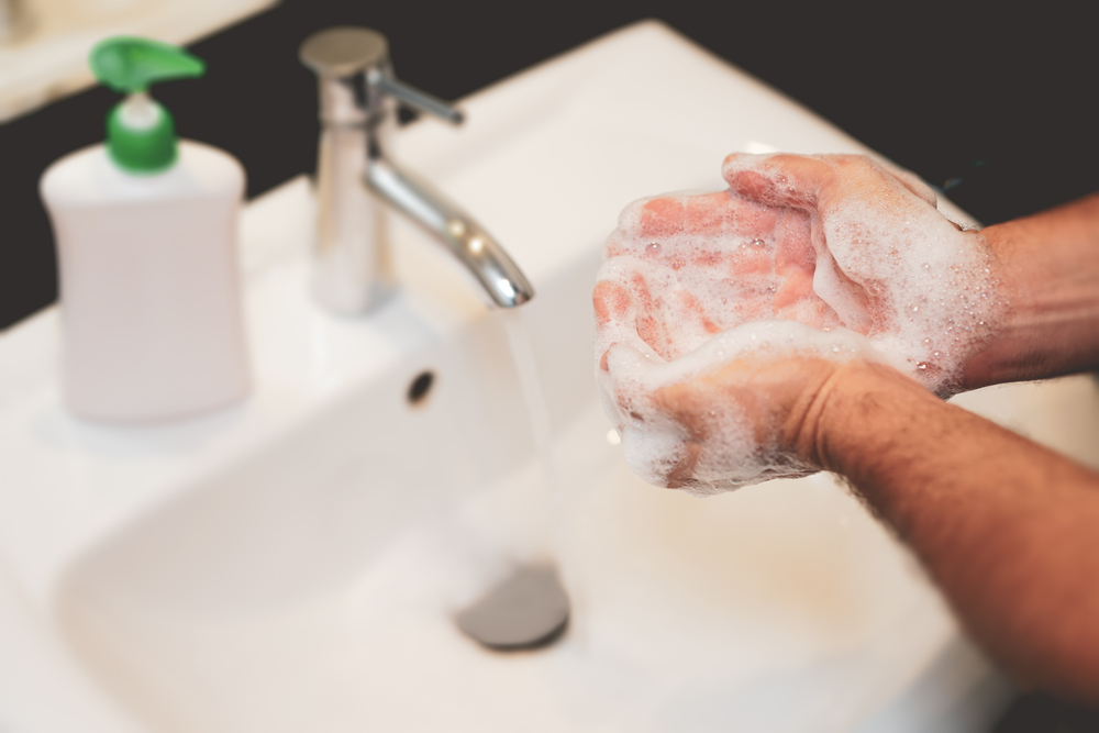 Shutterstock_1676348017 Men hands washing with soap
