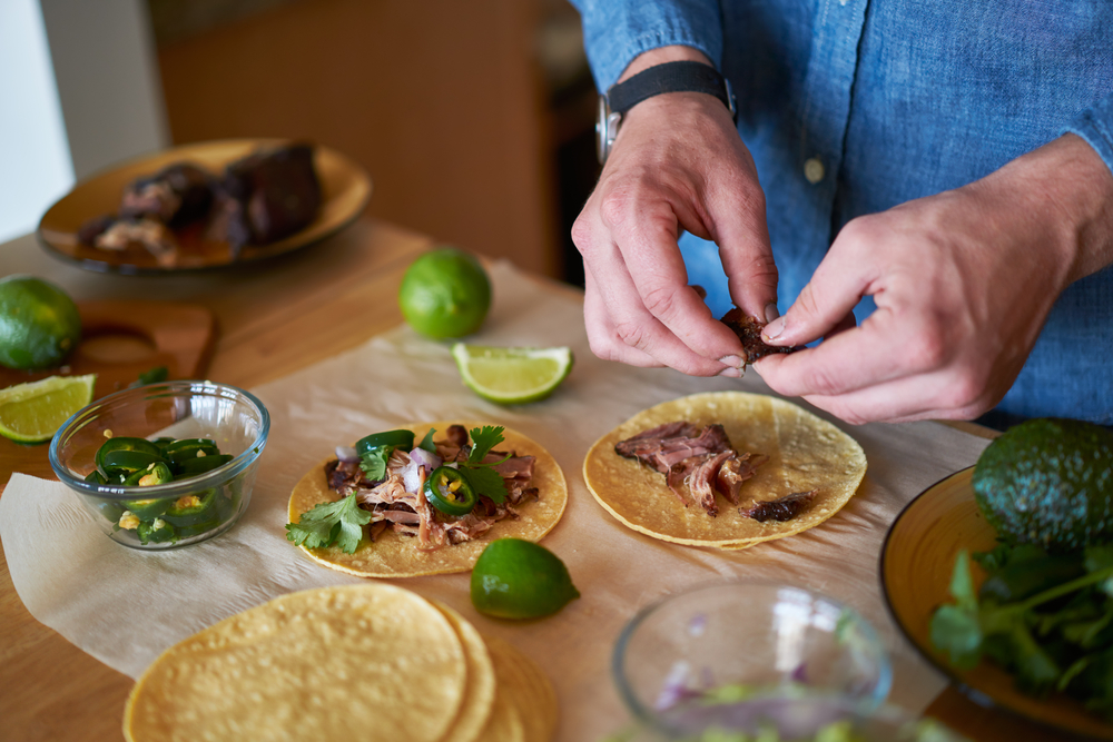 Shutterstock_515564944 making tacos at home in kitchen