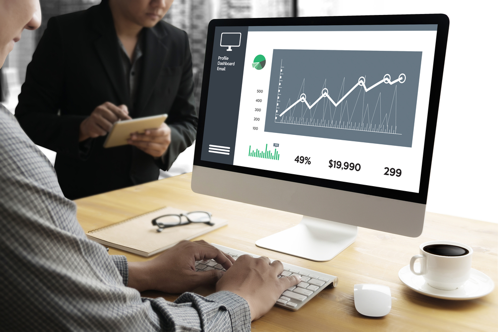 Shutterstock_583252960 Business Man Sales Increase Revenue Shares and Customer Marketing Sales Dashboard Graphics Concept