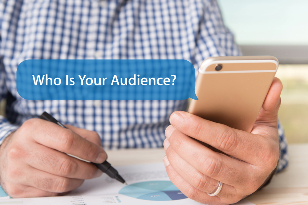 Shutterstock_524166397 COMMUNICATION TECHNOLOGY CONCEPT: WHO IS YOUR AUDIENCE? WORD ON CHAT BUBBLE