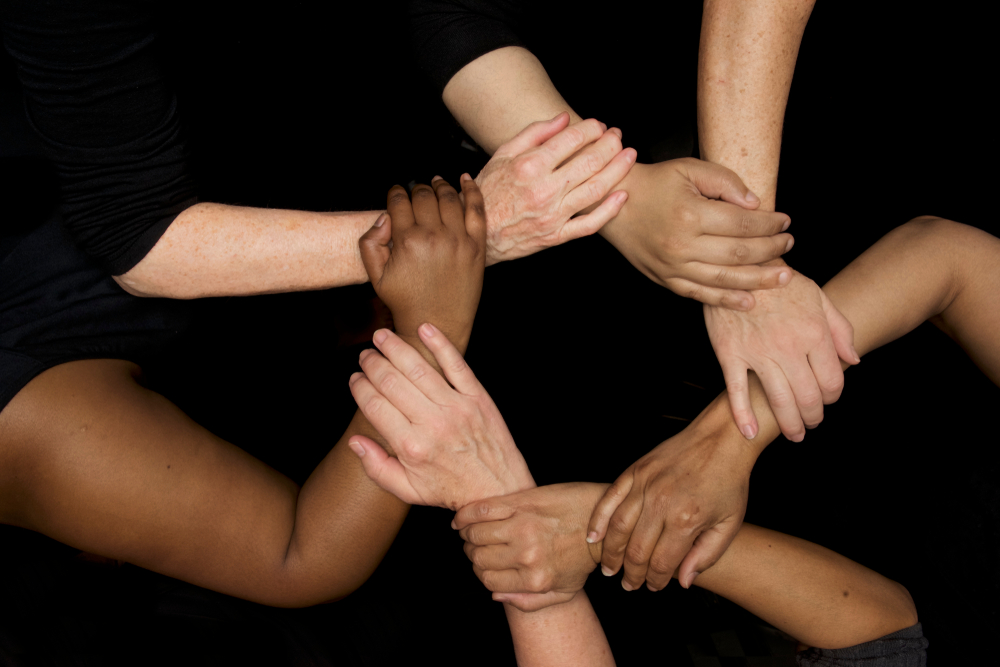 Shutterstock_1051498664 Hands of diversity and women's empowerment racial harmony