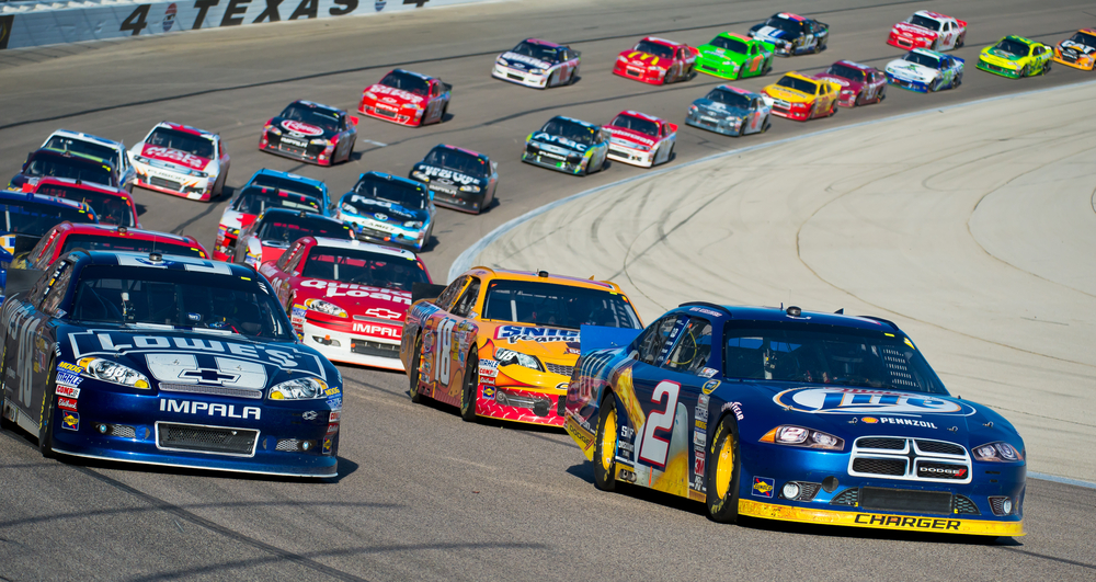 Shutterstock_117790654 DALLAS, TX - NOVEMBER 04: Brad Keselowski 2 and Jimmie Johnson 48 lead the field at the Nascar Sprint Cup AAA Texas 500 at Texas Motorspeedway in Dallas, TX on November 04, 2012