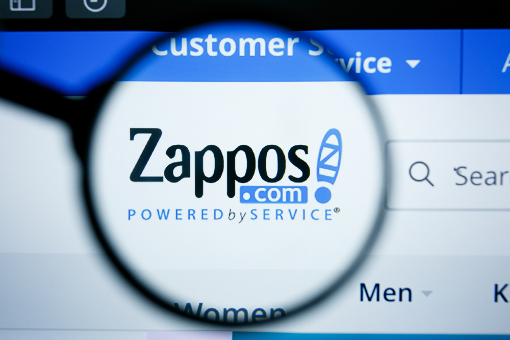 Shutterstock_1450974128 Los Angeles, California, USA - 25 June 2019: Illustrative Editorial of Zappos website homepage. Zappos logo visible on display screen.