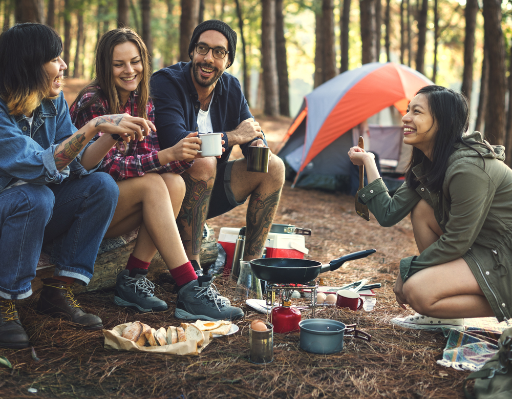 Shutterstock_520119067 Friends Camping Eating Food Concept