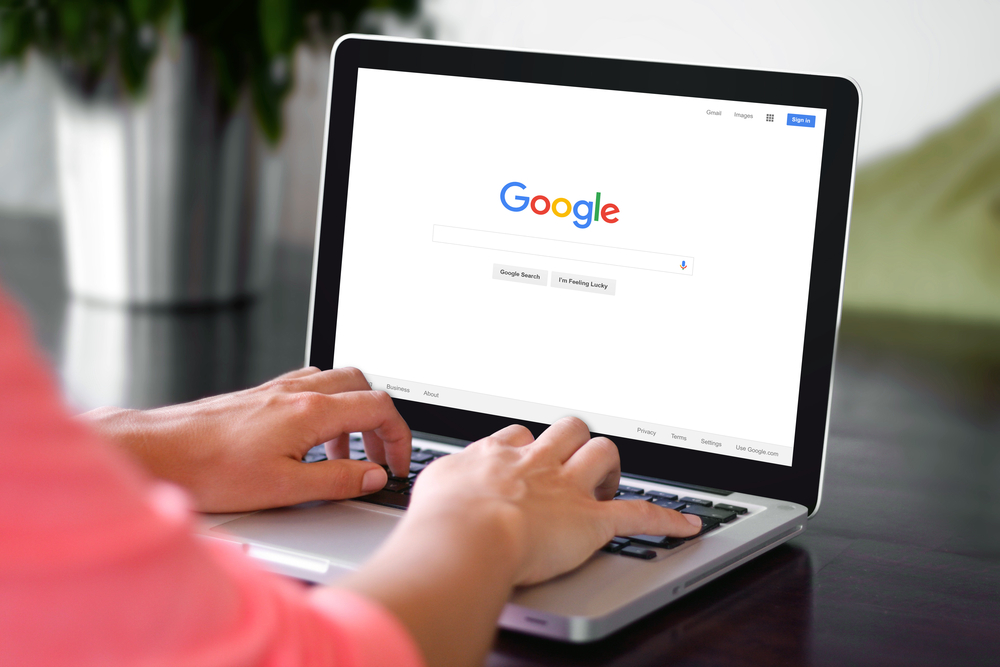 Shutterstock_344865374 BEKASI, INDONESIA - NOVEMBER 29, 2015: A woman is typing on Google search engine from a laptop. Google is the biggest Internet search engine in the world.