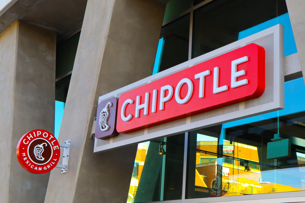 Shutterstock_1358720510 Glendale, California, United States – April 1, 2019: Chipotle Mexican Grill sign. Chipotle restaurant logo. Chain of casual dining restaurants specializing in burritos and tacos. Outdoor facade text.