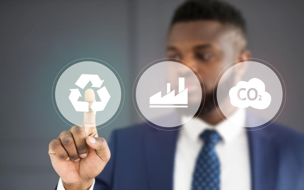 Shutterstock_1513979789 Businessman choosing renewable energy for sustainable development of company, modern technologies concept