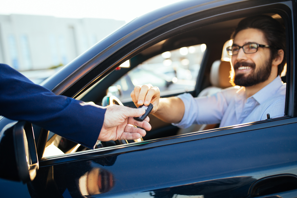 Shutterstock_752921596 Young and handsome businessman buying used car