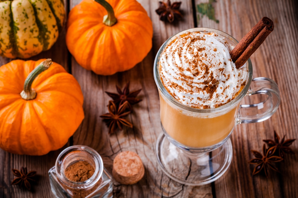 Shutterstock-505354150 Pumpkin spice latte with whipped cream on wooden table