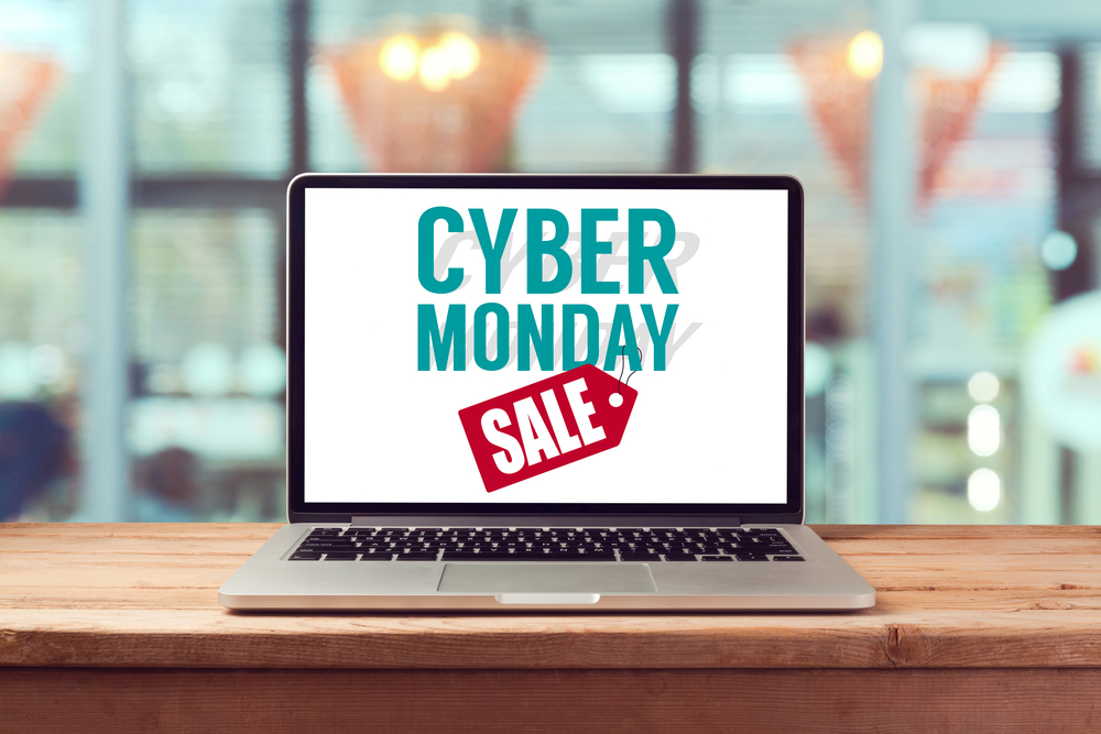 Shutterstock_332590928 Cyber Monday sign on laptop computer. Holiday online shopping concept. View from above