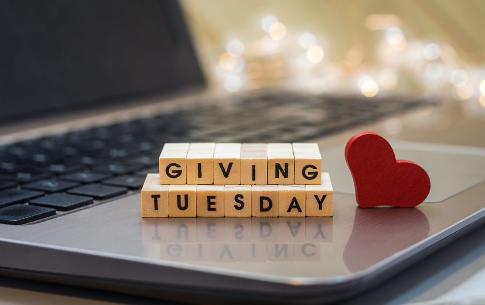 Shutterstock_1818963800 GIVING TUESDAY letter blocks concept on laptop keyboard