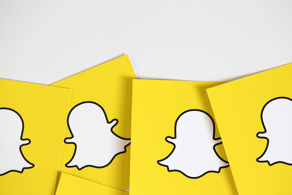 Shutterstock_529584769 OXFORD, UK - DECEMBER 5th 2016: Snapchat logos printed onto paper. Snapchat is a popular social media application for sharing messages, images and videos