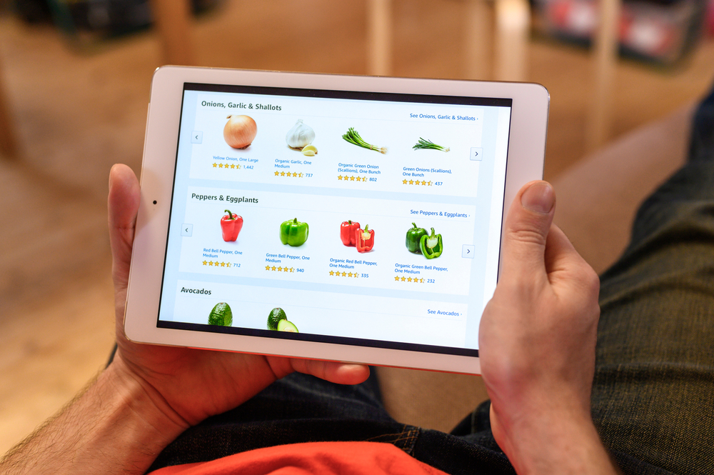 Shutterstock_1712530282 Smakhtino / Russia - April 2020: a lone male ordering products with home delivery in the online grocery store, using a tablet, stay safe at home during the quarantine because of coronavirus covid-19