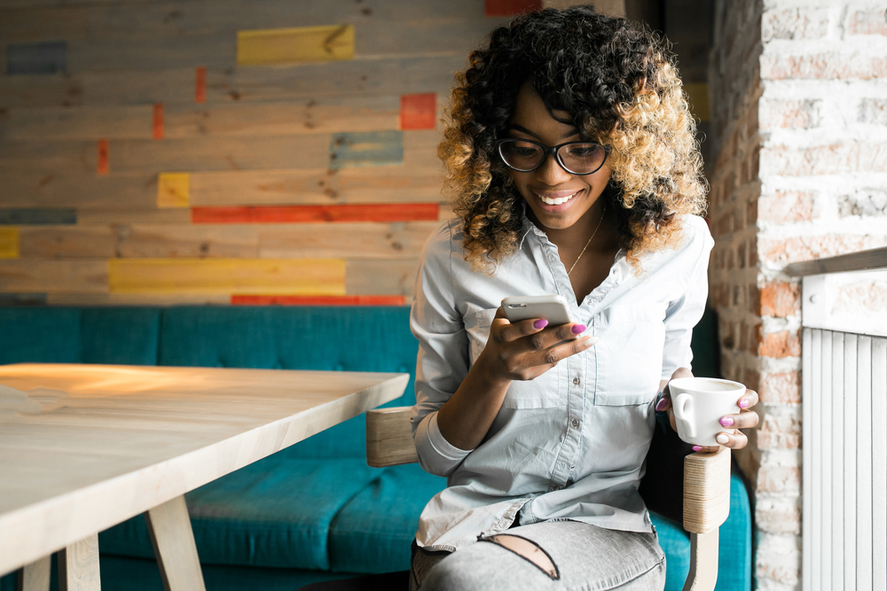 Shutterstock_606913400 african american woman using phone