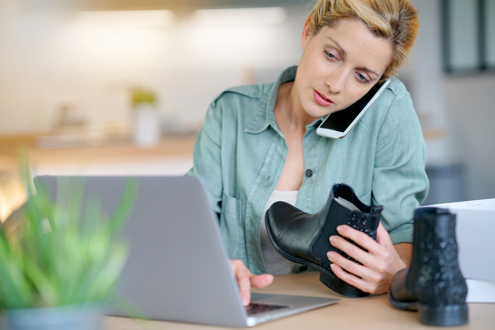 Shutterstock_579102145 Woman on the phone with customer service department