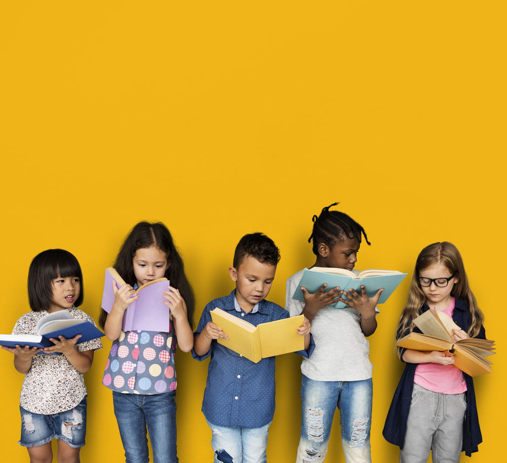 Shutterstock_638180248 Diverse Group Of Kids Study Read Book