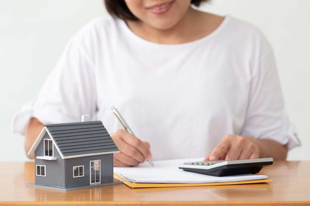 Shutterstock_1715822683 Woman preparing documents file for loan home and refinance