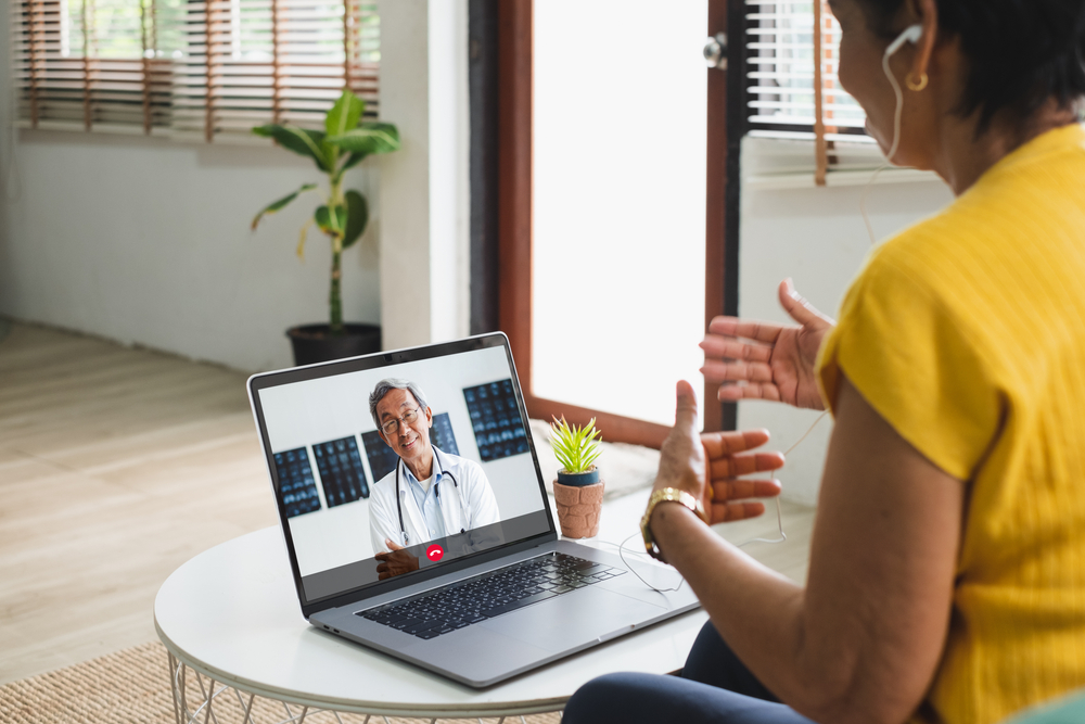 Shutterstock_1755938462 Asian senior video call with doctor telemedicine telehealth concept