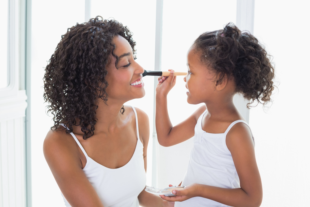 Shutterstock_207787321 Cute daughter putting makeup on her mothers face at home in the bathroom