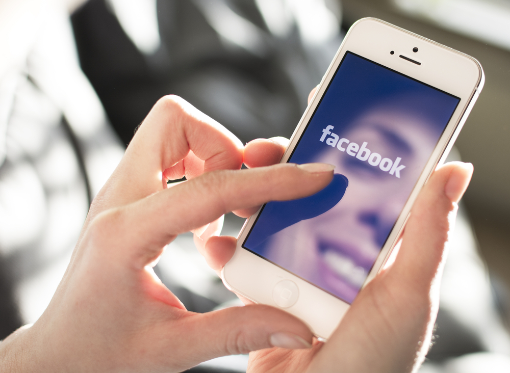 Shutterstock_173594528 HILVERSUM, NETHERLANDS - JANUARY 28, 2014: Facebook is an online social networking service founded in February 2004 by Mark Zuckerberg with his college roommates and is now a fortune 500 company.