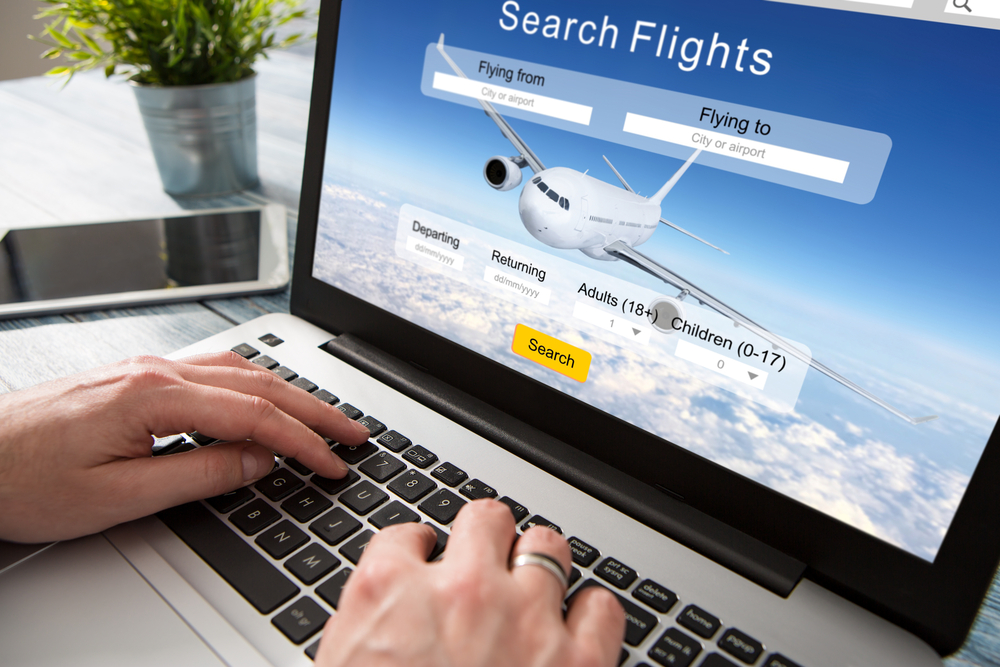 Shutterstock_520314439 booking flight travel traveler search ticket reservation holiday air book research plan job space technology startup service professional now marketing equipment concept - stock image